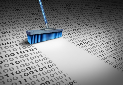 A broom sweeps a clear path through a sheet of ones and zeros - a representation of data cleaning.